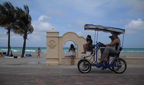 The Hollywood Beach Broadwalk is busy with four-wheeled bike buggies, so it's not a place for speed. (Photo: Bonnie Gross)
