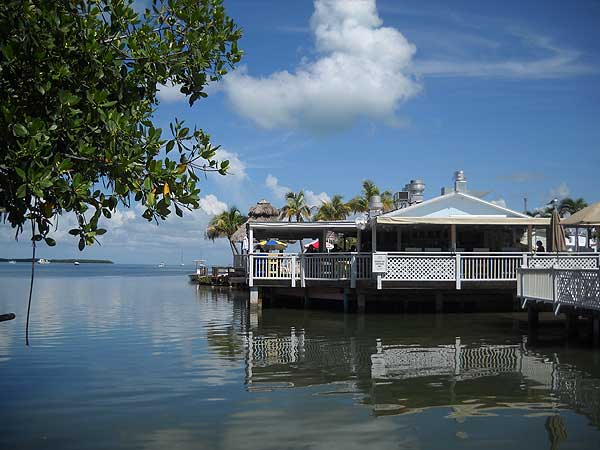 Put this on your list of stop for a tiki bar weekend getaway in Florida : It would be harder to find Florida Keys tiki bar with a more beautiful setting than Lorelei in Islamorada. (Photo: Bonnie Gross)