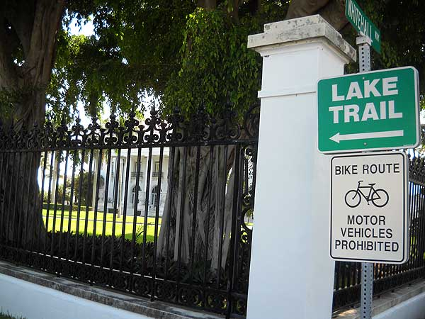 lake trail sign Lake Trail: Bicycle past Palm Beach mansions along the water