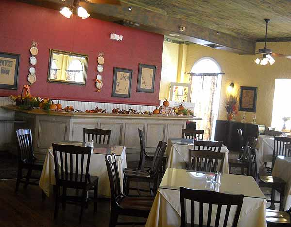 The Seminole Inn Indiantown: The dining room with hardwood floors and pecky cypress ceiling is called the Windsor Room.
