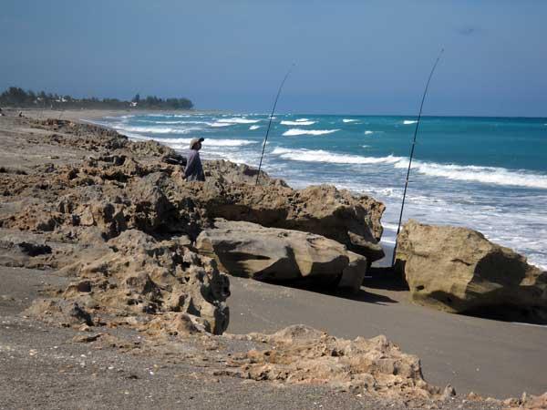 Fishermen at Blowing Rocks Preserve, Jupiter, Florida, beach