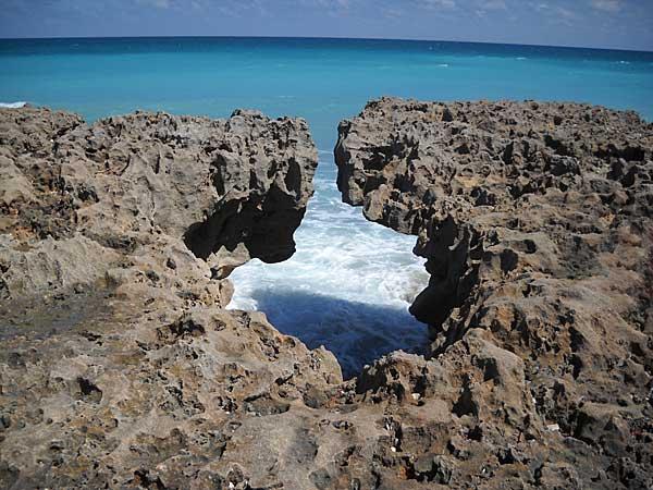 Rocks frame an ocean view at Blowing Rocks Preserve, Jupiter, Florida, beach