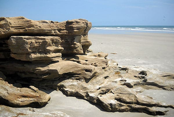 The Washington Oaks beach is lined with sculpted rocks.