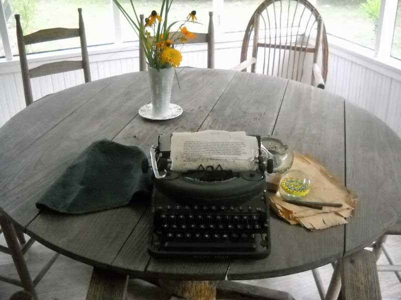 Porch at Marjorie Kinnan Rawlings Historic State Park: An old typewriter and pack of Lucky Strikes look like she just stepped away.