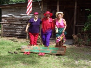 log cabin grape stomp Florida wineries stomp grapes at harvest festivals