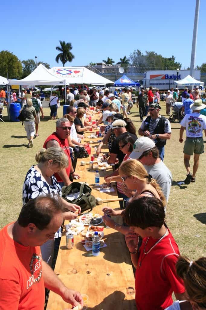 Folks eating seafood Marathon Seafood Festival