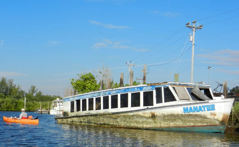 Derelict boat in Barron River in Everglades City
