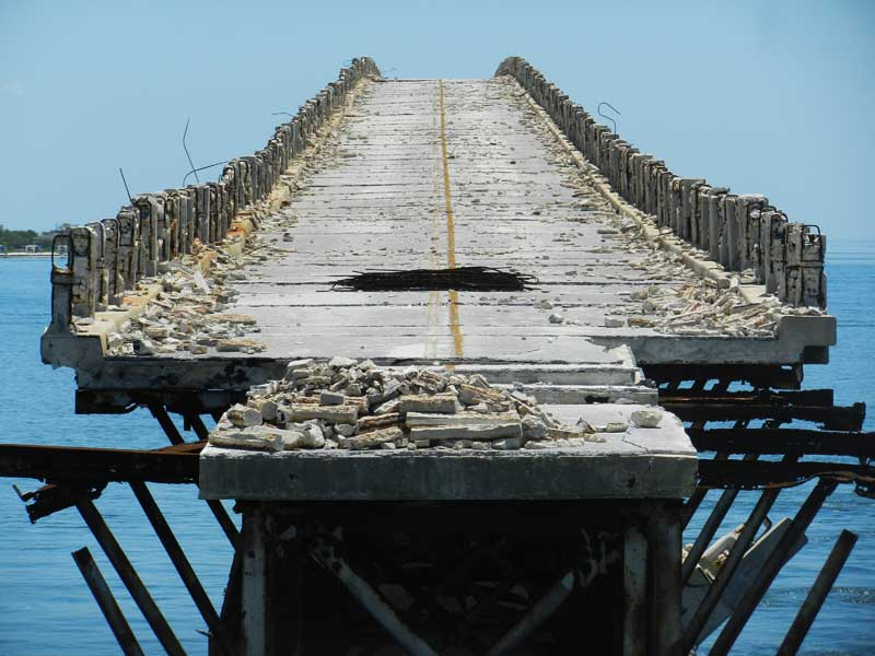 View of old and crumbling Bahia Honda bridge from the southern end.