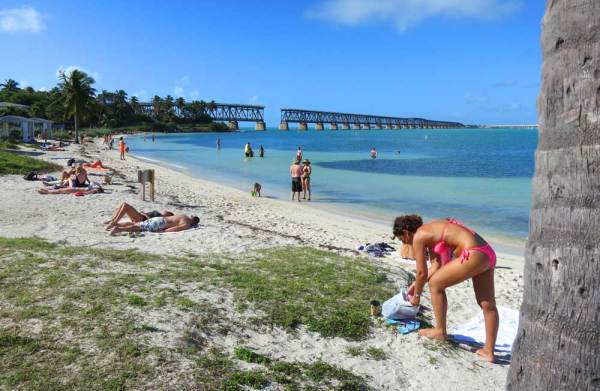 Calusa Beach at Bahia Honda State Park in the Florida Keys is one of the Keys' top beaches. But we love that old bridge you see in the background -- one of several reasons we think this is one of the seven best Florida state parks. (Photo: Bonnie Gross)
