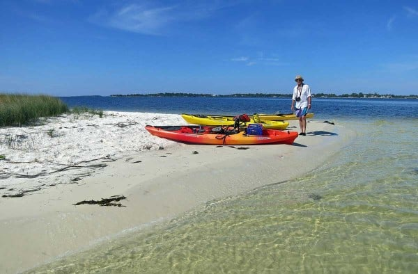 Clear water and a pristine beach await you on a kayak trip to Atsena Otie Key., an island you reach by kayak when you visit Cedar Key.