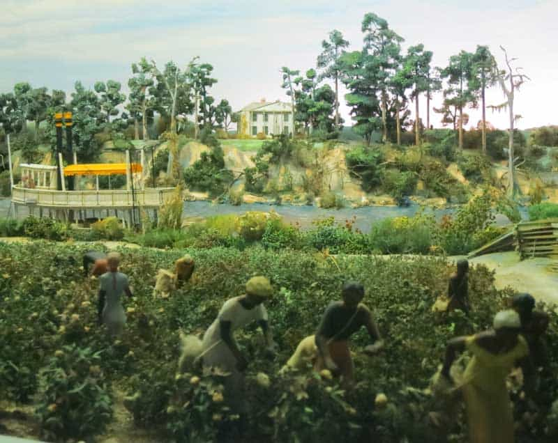 """This diorama at the Stephen Foster Museum in Stephen Foster State Park shows slaves in cotton fields with the plantation house and paddlewheel boat in the background. It illustrates the song """"Swanee River."""" (Photo: David Blasco)"""