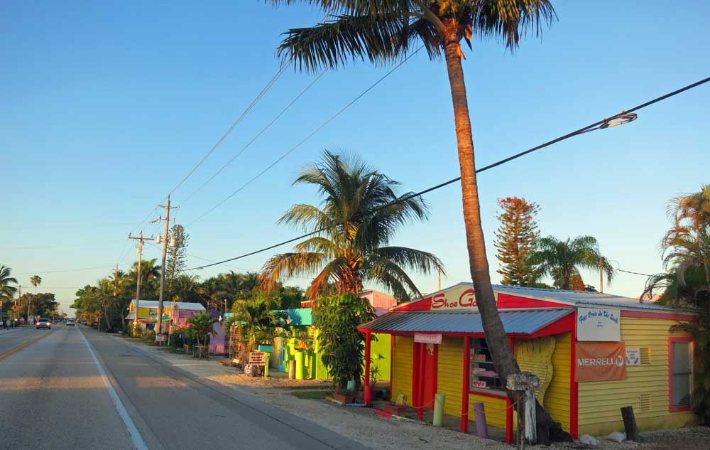 The single highway through the center of Matlacha FL is lined with small wooden cottages in bright colors.