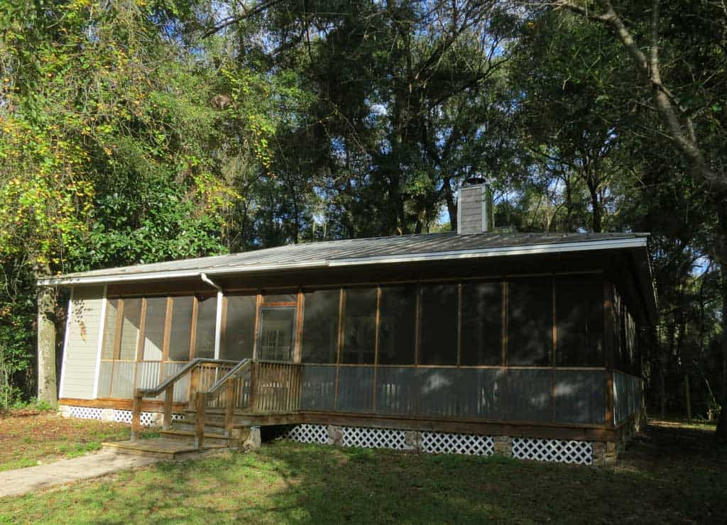 Two-bedroom cottages at Fanning Springs State Park are surrounded by forest and are close to the spring.