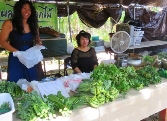 The Sunday market at the Tampa Buddhist temple includes booths selling vegetable and herbs.