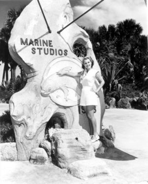 Woman standing at the entrance to Marine Studios - Marineland, Florida. 1949. Black & white photoprint, 5 x 4 in. State Archives of Florida, Florida Memory.