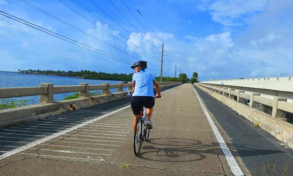 Biking in Key West on one of the scenic bridges on the Florida Keys Overseas Heritage Trail from MM 15 to MM 5.