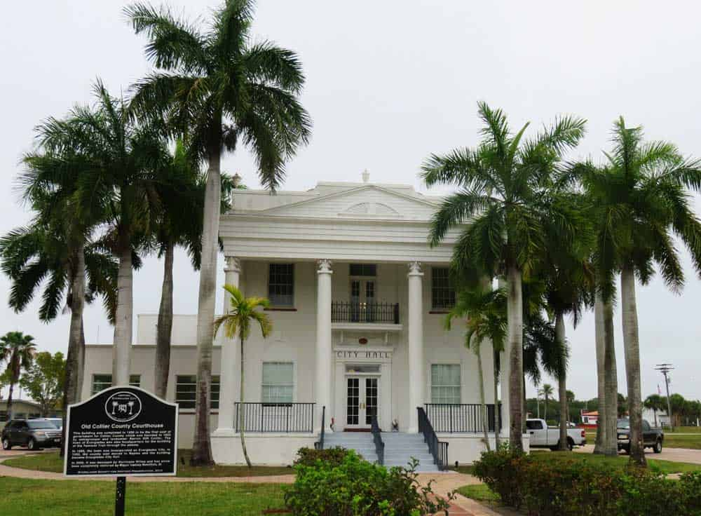 Everglades City was built around a circular road, with the Run and Gun Club one side and this neo-classical city hall (formerly the county building) on another. (Photo: Bonnie Gross)