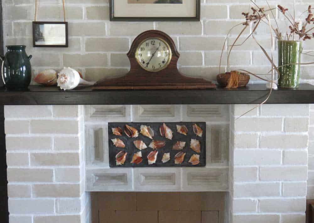 The fireplace in the Mound House at Fort Myers Beach was carefully restored to match the way it appeared in an old family photo. (Photo: Bonnie Gross)