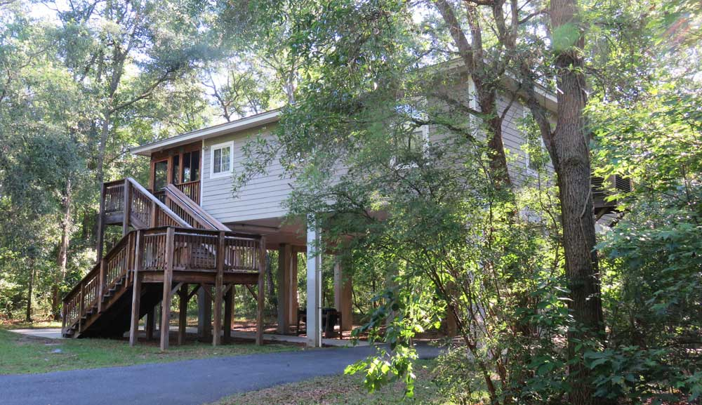 Lafayette Blue Springs State Park cabins are expansive two-bedroom houses on stilts set in quiet woods. (Photo: Bonnie Gross)