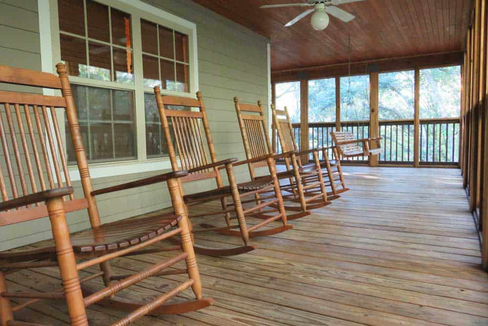 There's a row of rocking chairs on the large, wrap-around porch in the Lafayette Blue Springs State Park cabins. (Photo: Bonnie Gross)