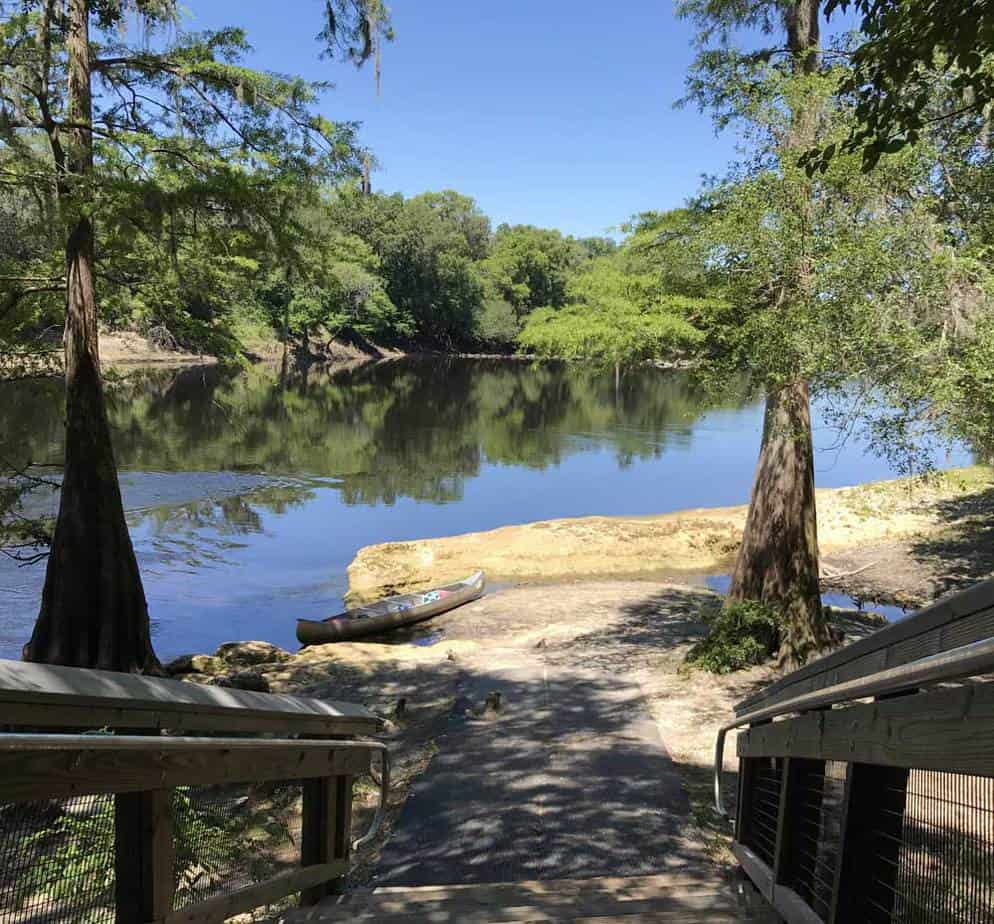The Peacock Slough camp site is one of the fabulous paddle-in campsites that are part of the Suwanee River state park system. The stop is a good place to use indoor restrooms and well-shaded picnic tables. It is on the bluff overlooking the Suwanee, and you couldn't find a prettier place to spend time. (Photo: Bonnie Gross)