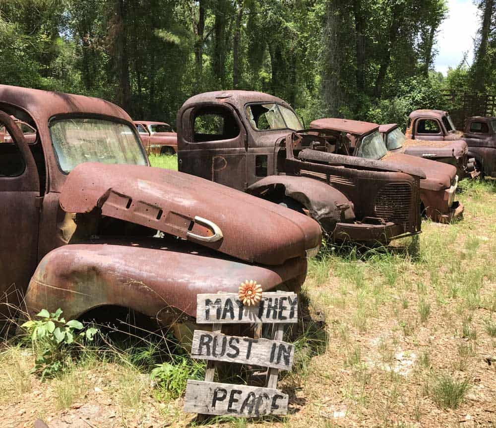 Harvey's Historic Truck Display is a field of rusting antique cars and trucks that people love to photograph as they explore the Big Bend Scenic Byway