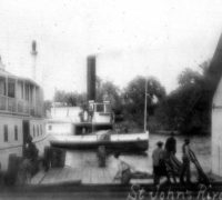 "The steamboat ""Louise"" ties up at Blue Spring Landing."