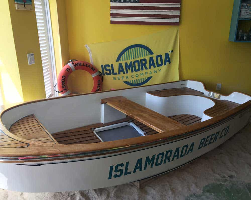 Florida Keys breweries: Boat and sand pile whree kids can play in the Islamorada Beer Company tasting room.