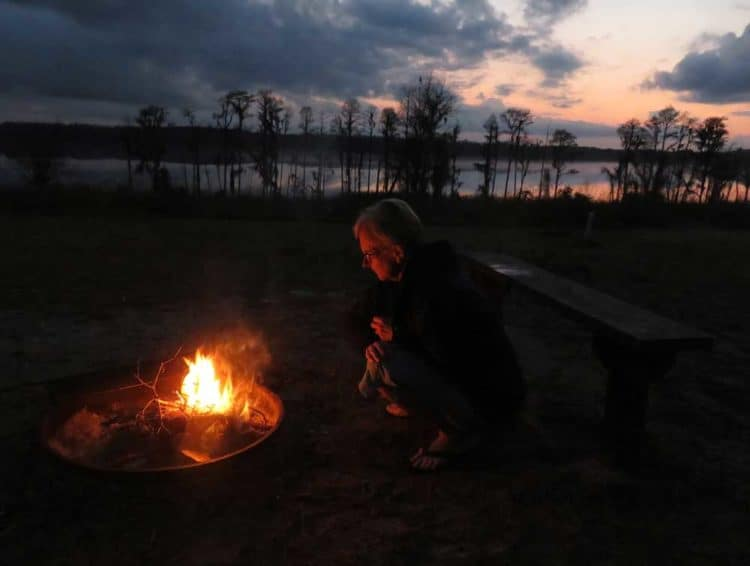 Each of the cabins at Lake Louisa State Park in Clermont has a fire ring, a perfect place to watch the sunset over Dixie Lake.