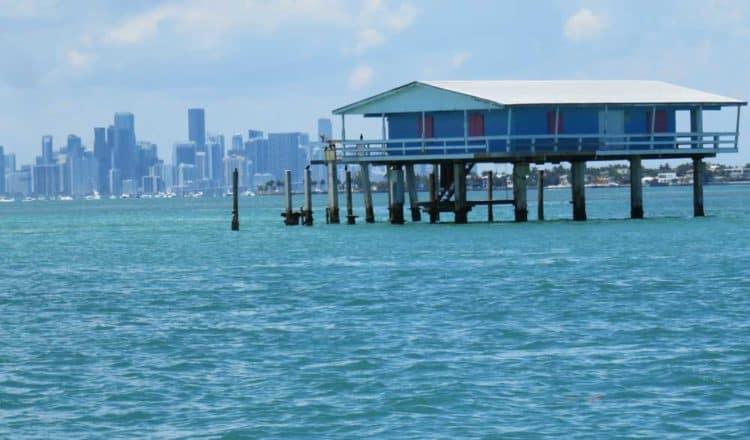 The Jimmy Ellenburg House on Stiltsville tour with Miami skyline. (Photo: Bonnie Gross)