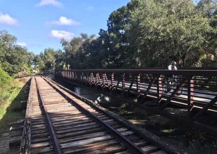 Train trestle adjoining bike path.