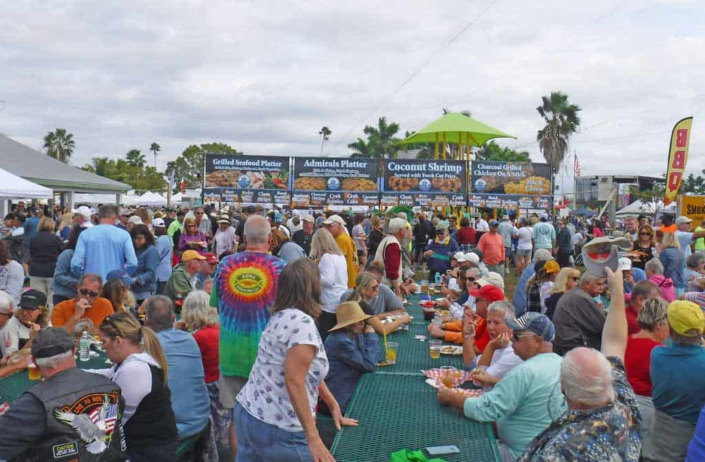 Crowds at tables at Everglades city seafood festival.