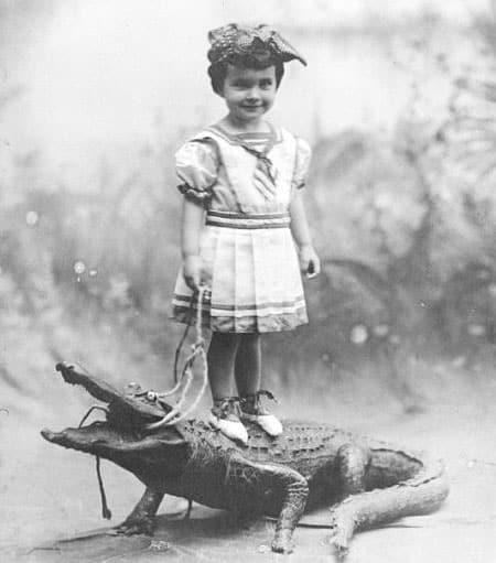 Dallas Mercier Conklin atop a stuffed alligator. Studio photographs like this 1908 photo were popular. (Photo: History Miami)