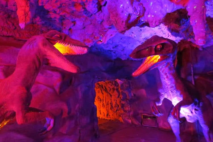 Florida roadside attractions: Boyett's Citrus in Brooksville features a cave with animated dinosaurs illuminated by black lights. (Photo: Doug Alderson.)