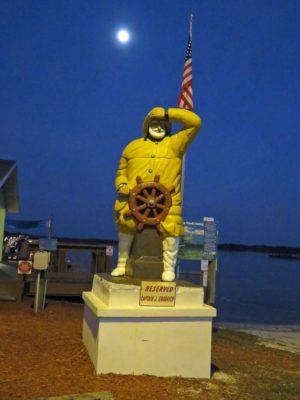 A statue outside Goodrich Seafood in Oak Hill, Florida,  honors Captain Goodrich. (Photo: David Blasco)