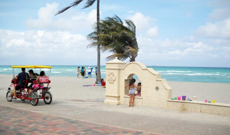 Surreys are popular bike rentals for families at Hollywood Beach Broadwalk. (Photo: Bonnie Gross)