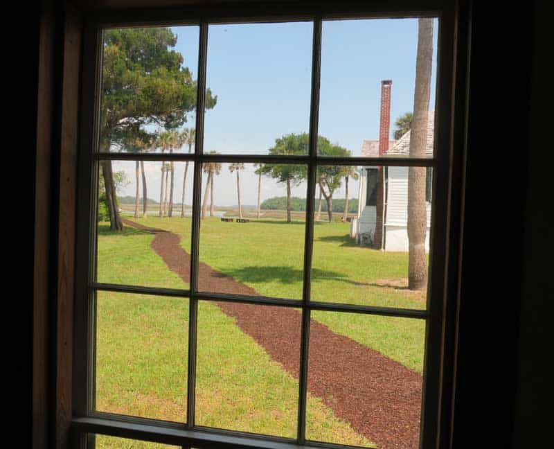 The view from the kitchen, which was a separate building, looking toward the main house and waterfront.