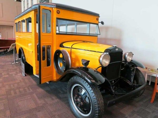 Kids love to romp on the vintage school bus at the Elliott Museum, Stuart, Florida.