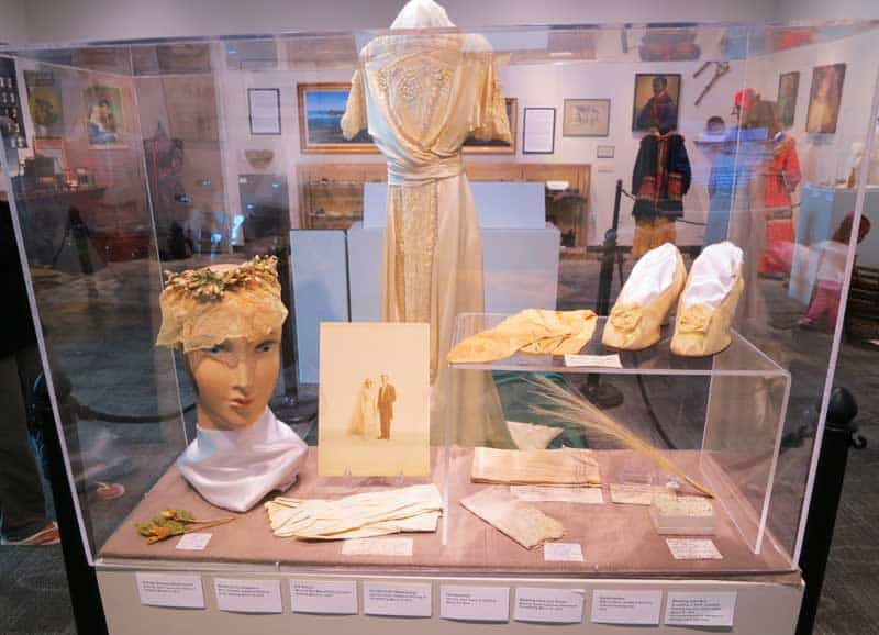 The wedding dress was worn by five members of the same local family. The wedding photos are displayed, too, at the Elliott Museum. Stuart, Florida.