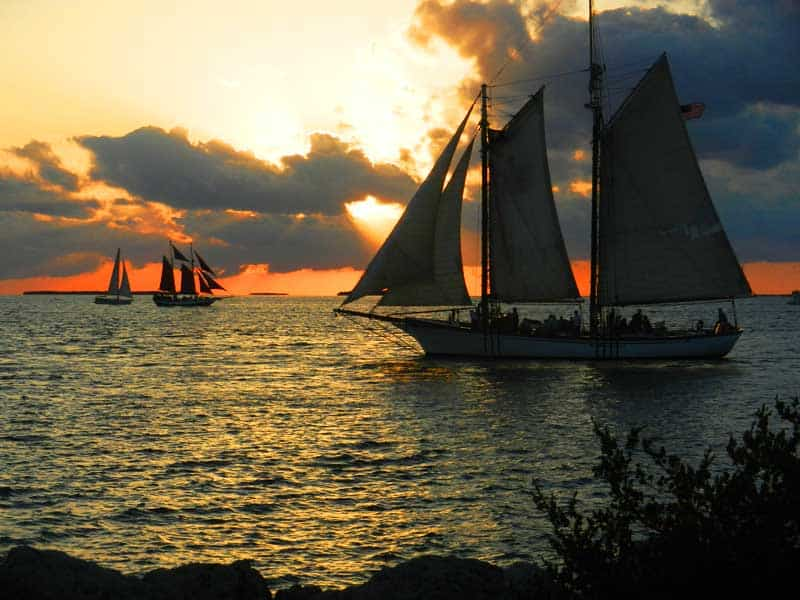 The schooner Western Union on a sunset cruise sails past Fort Zachary Taylor.