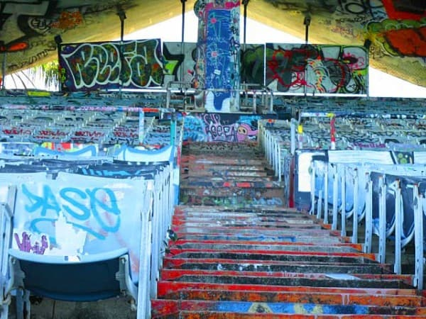 The old Miami Marine Stadium on Virginia Key looks like the graffiti-covered vestige of a lost civilization