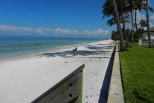 This empty Naples beach can be accessed by a pocket park.