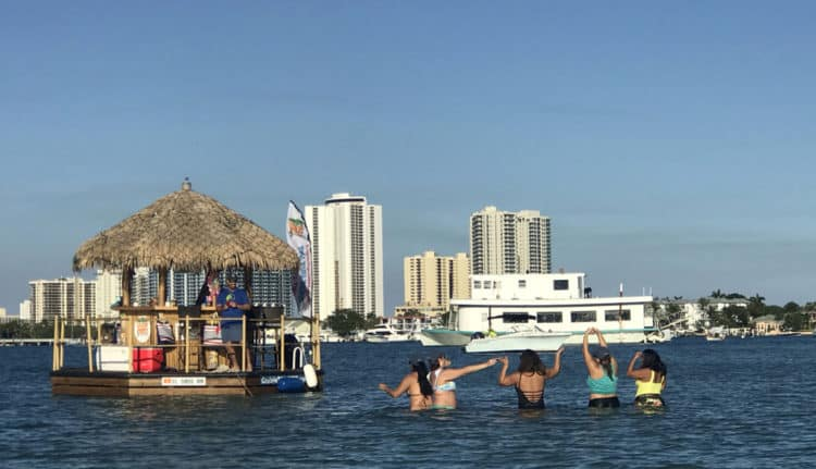 Peanut Island is a popular destination for partying boats. This floating tiki bar brought a sunset celebration to the shoreline. (Photo: Bonnie Gross)
