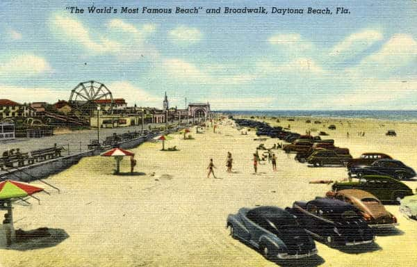 Driving on the beach in a vintage postcard.
